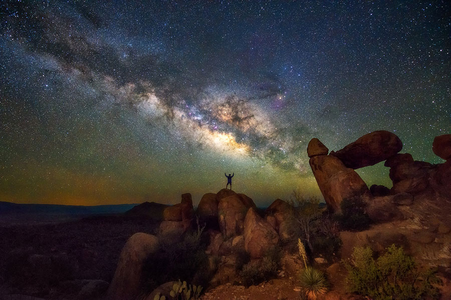 person on top of rock at Big Bend National Park at night