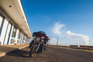 motorcycle in front of Riata Inn Marfa rooms